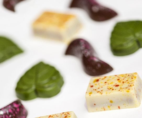 Pralines called yuzu, with brigh green, pink and beige colors